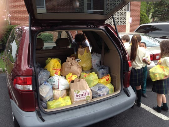 Our Lady of Perpetual Help School students brought over 1500 canned goods and other non-perishable items to the Maple Shade Food Pantry this month.