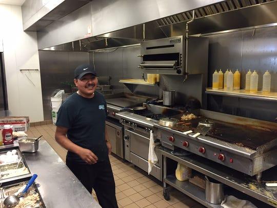 Alex Cruz mans the grill at Old 41 Restaurant.