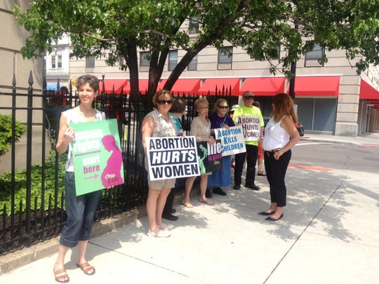 Pro-life advocates gather Thursday to protest a visit to Cincinnati by Cecile Richards, national president of Planned Parenthood.