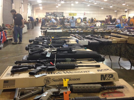 A line of rifles were for sale at the T&T Sporting Goods tables at the R.K. Gun and Knife Show Sunday.