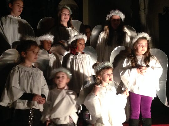 Little angels sing Christmas hymns Sunday night at St. Luke's Episcopal Church's Feast of Lights.