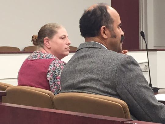 Kendra Manuel, seated next to her lawyer Edward Corley, was convicted of knowingly taking items from two gravesites in Shiloh in March. She was sentenced to jail time and counseling, and barred from Mount Hope Cemetery.