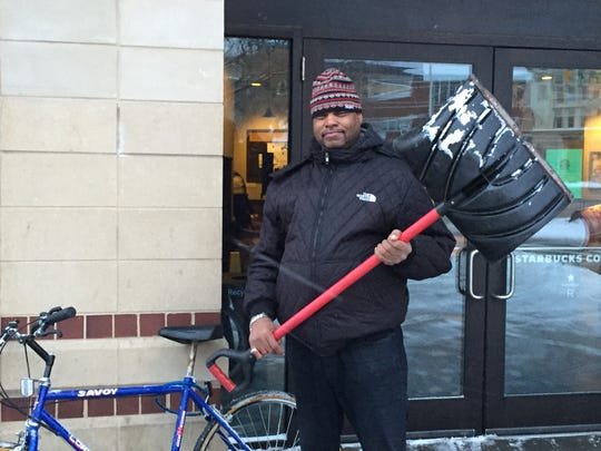 Morristown resident, armed with a critical winter tool, pedaled to the Green Tuesday to find shoveling jobs.