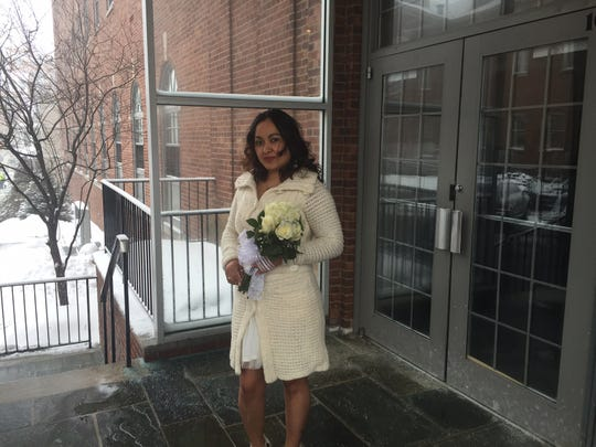 """Itzel Guerrero waits for Fiancé Alfredo """"Carlos"""" Tamay outside Morris County Administration building where county Clerk Ann Grossi performed their marriage ceremony."""