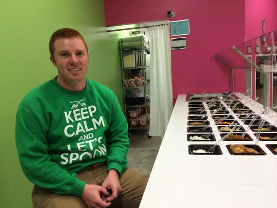 Trake Carpenter, owner of Let's Spoon frozen yogurt.