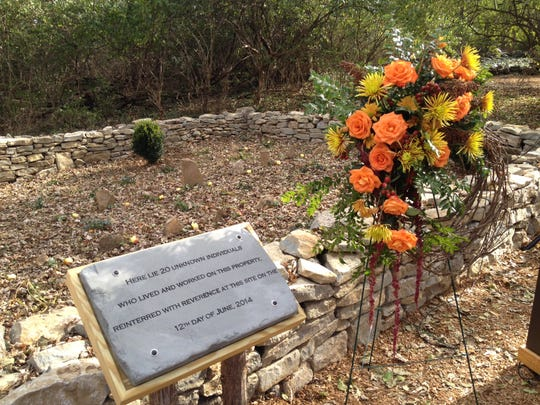 Stones mark the graves of 20 people, believed to be
