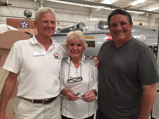 From left, Palm Springs Air Museum volunteer Dave Thompson, Monnie Lutz and air museum managing director Fred Bell. Lutz donated a POW/MIA bracelet bearing the name of Lt. Col. Robert Sawhill Jr. to the museum on Monday.