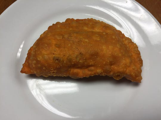An empanada can be enjoyed for $2 at Tropical Delight.