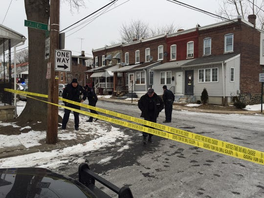 Wilmington police investigate at the corner of 24th and Carter streets, where 17-year-old Deshon Sellers was fatally shot Feb. 16.