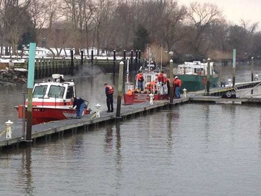 Rescue crews return to dock in the old canal at Delaware City.