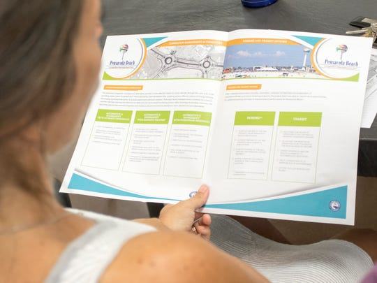 Dione Dunn reads a pamphlet featuring the latest plans to help beach traffic congestion that were unveiled during a meeting at the Beach Community Church in Pensacola on Tuesday, October 25, 2016.