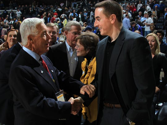 November 5, 2012 -   Former Memphis Grizzlies majority owner Michael Heisley, left, greets Memphis Grizzlies chairman Robert Pera following Monday evening's home opener against the Utah Jazz.  (The Commercial Appeal/ Nikki Boertman)