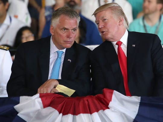 Virginia Gov. Terry McAuliffe, left, with President