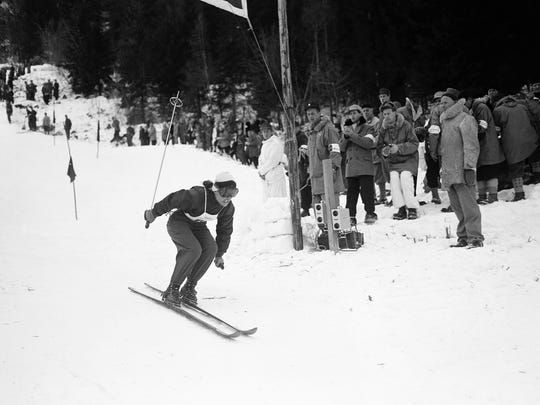 Andrea Mead Lawrence, of Rutland, Vt., flashes across finish line to win the women?s giant slalom in the Winter Olympics at Norefjell in Norway on Feb. 14, 1952. Her time was 2:6.8,-- 2.1 seconds faster than the time of runner-up Dagmar Rome of Austria.