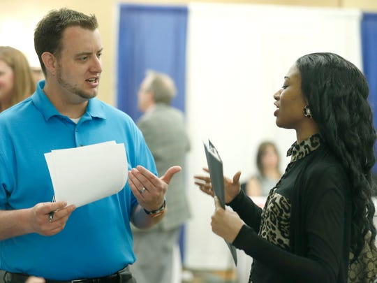 Corporate recruiter with Concentrix Adam Graham talks to Maranda Triplett, who was looking for a customer service position during the Career Expo 2015 at the DoubleTree by Hilton Hotel Rochester.