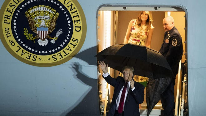 President Donald Trump with First Lady Melania arrive at Palm Beach International Airport in West Palm Beach, Friday, Jan. 31, 2020.