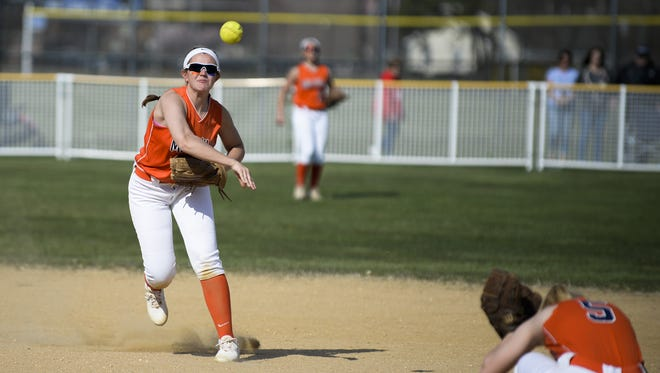 Millville's Megan Sooy throws the ball to first against Vineland earlier this season.