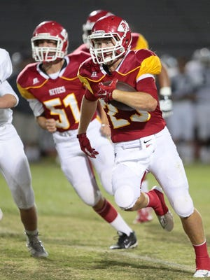 Palm Desert's Beau Berryhill carries the ball for a touchdown against the Redlands Terriers in the first quarter on Friday in the Palm Desert.