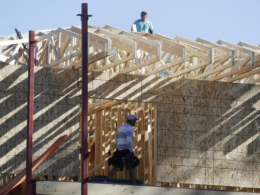 Workers on new home,r m,housing,real estate,construction,economy