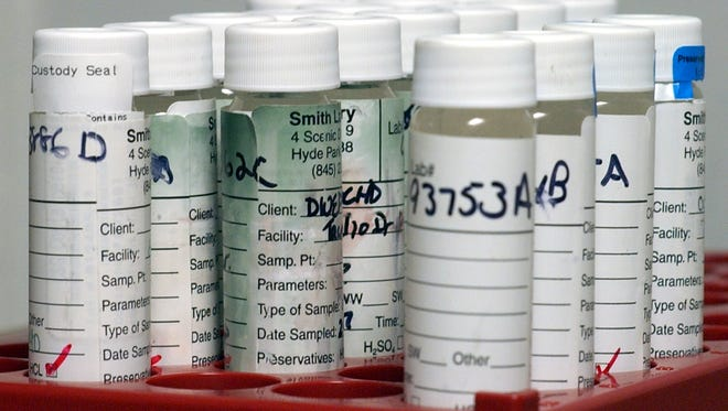 Samples of well water are lined up to be tested by several different water testing machines for organic and inorganic substances at Smith Laboratories in Hyde Park in 2007.