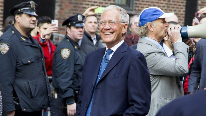 David Letterman is seen outside the Ed Sullivan Theater in 2014.