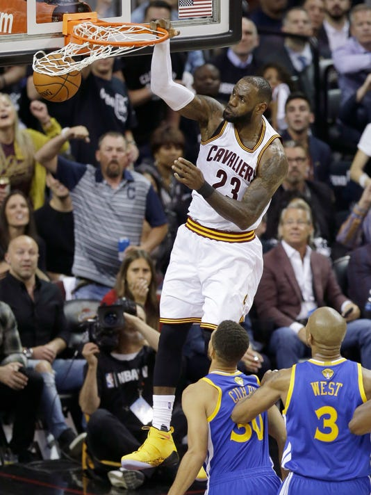 Cleveland Cavaliers forward LeBron James (23) dunks against the Golden State Warriors during the first half of Game 4 of basketball's NBA Finals in Cleveland, Friday, June 9, 2017. (AP Photo/Tony Dejak)