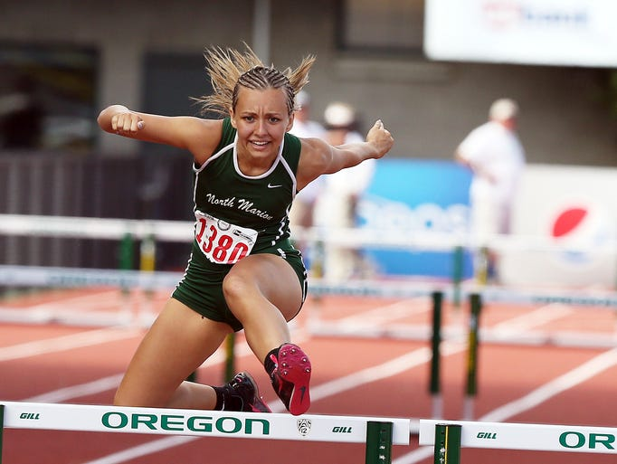 North Marion's Hannah Waite wins the 4A Girls 300 Meter Hurdles at the OSAA 4A/5A/6A State Track Meet at Historic Hayward Field in Eugene Saturday May 24, 2014.