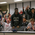 Southern Utah football players react to the announcement of Demario Warren as their new head coach, Sunday, Jan. 10, 2016.