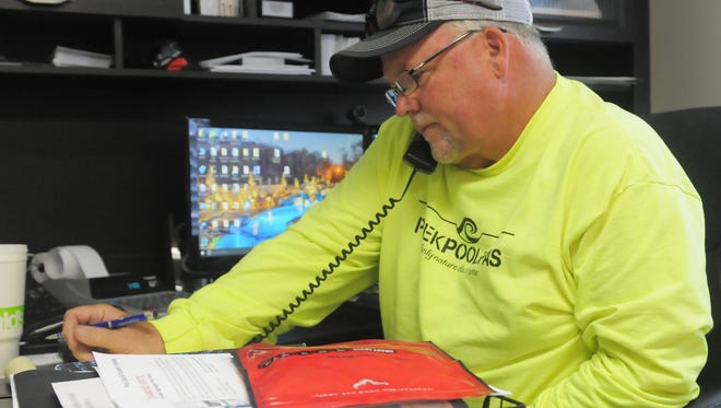 Kyle Peek gets calls from clients across the country about new pool projects he is requested to work on.