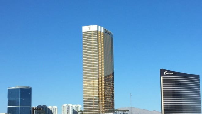 The shimmering golden hotel-condo development rises above the Vegas skyline, a partnership between President Trump and real estate mogul Phil Ruffin.