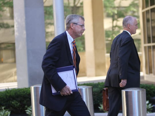 Left, William B. North, 55, former Wilmington Trust chief credit officer, arrives at J. Caleb Boggs Federal Building in October 2017.