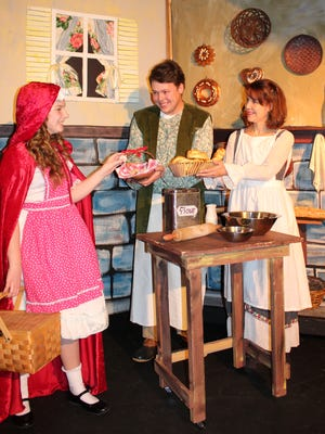 "Little Red Riding Hood (played by Abby Simon, left), the Baker (Kenny Roggenkamp) and the Baker's Wife (Jean Cavaliere) are among the fairy-tale characters in ""Into the Woods.""  The Stephen Sondheim-James Lapine musical runs at Brundage Park Playhouse in Randolph February 16 through March 4."