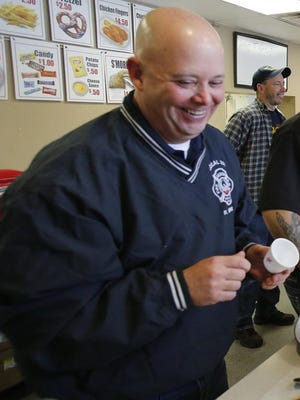 Russ Brode enjoys the Chili Challenge at Lock 3 in 2015. Brode, an Akron firefighter for nearly three decades, died Saturday at age 54.
