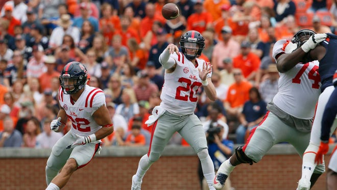 Ole Miss Rebels quarterback Shea Patterson (20) throws a pass against the Auburn Tigers during the first quarter at Jordan-Hare Stadium.