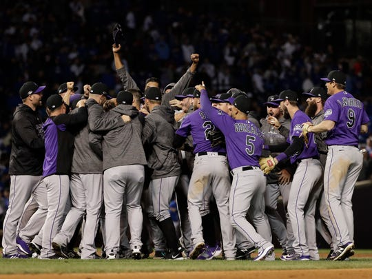 Colorado Rockies players celebrate after the Rockies defeated the Chicago Cubs 2-1 in the National League wild-card playoff baseball game Tuesday, Oct. 2, 2018, in Chicago. (AP Photo/Nam Y. Huh)