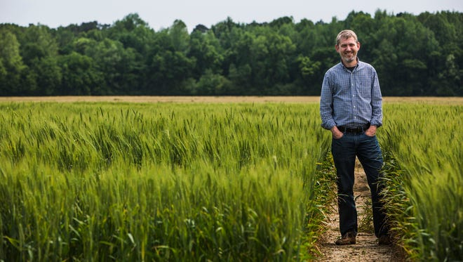 Pete Nelson, president of AgLaunch, stands in a field at the AgriCenter on May 3, 2018.