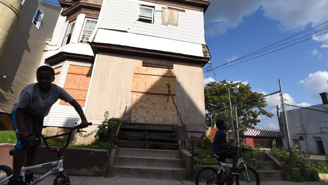 About six months ago, city officials launched a crackdown after two teenagers were shot – one fatally – inside a notorious drug den at 87 Auburn Street. The city declared the building a public nuisance and sent municipal employees to cover the windows and doors with wooden boards.