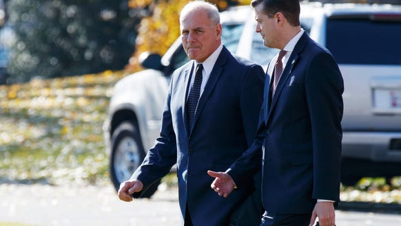 White House Chief of Staff John Kelly, left, walks