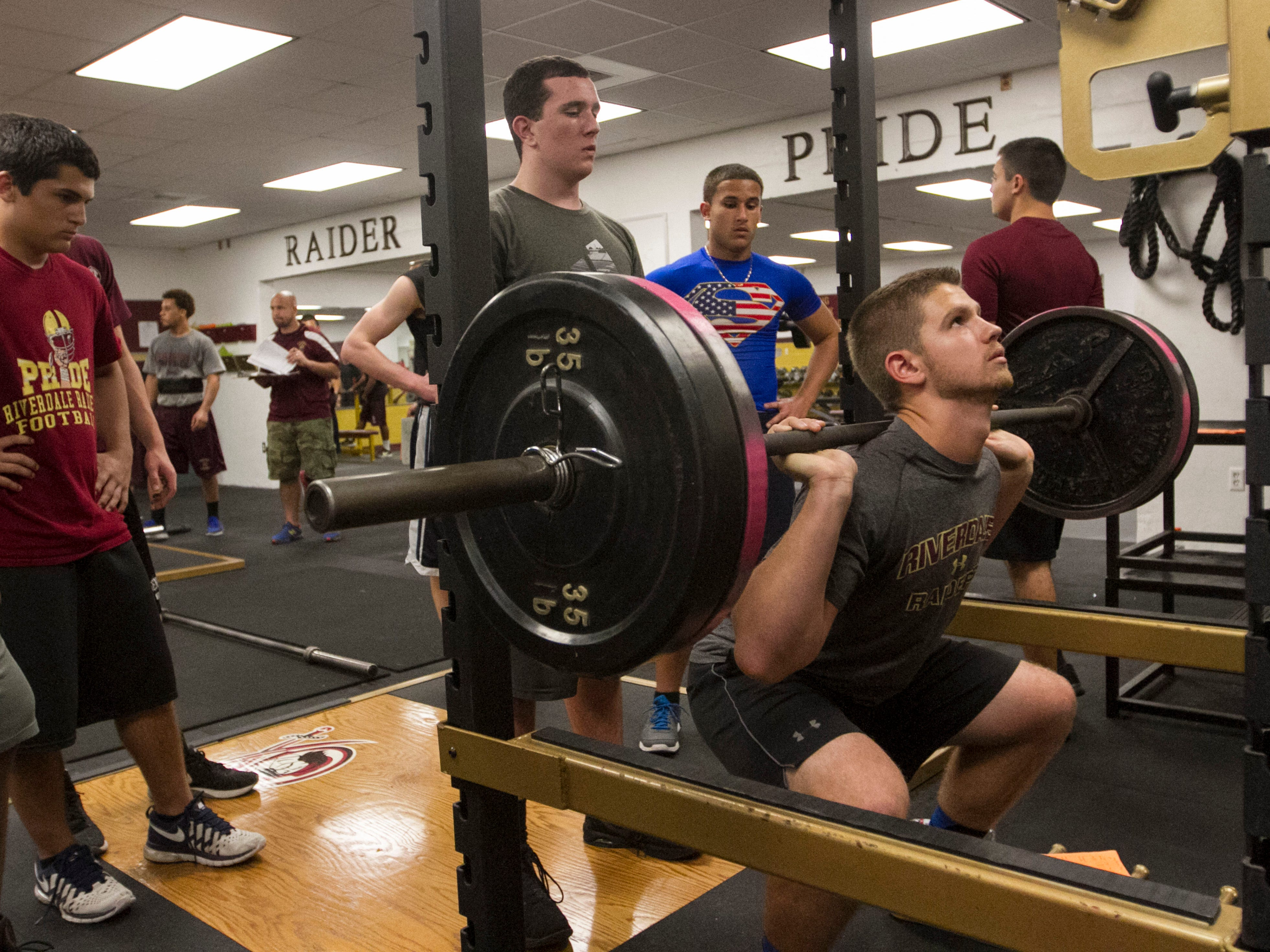 Riverdale spring football player Casey Drovdlic squats during skills testing for the team at Riverdale High School.