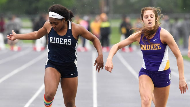 Waukee's Talia Buss(right) narrowly beats Roosevelt's Briyana Carter in the 100-meter sprint during a state qualifying track meet held at Waukee High School on Thursday, May 14, 2015.