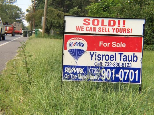 A sign advertises property sold on Whitesville Road in Jackson.
