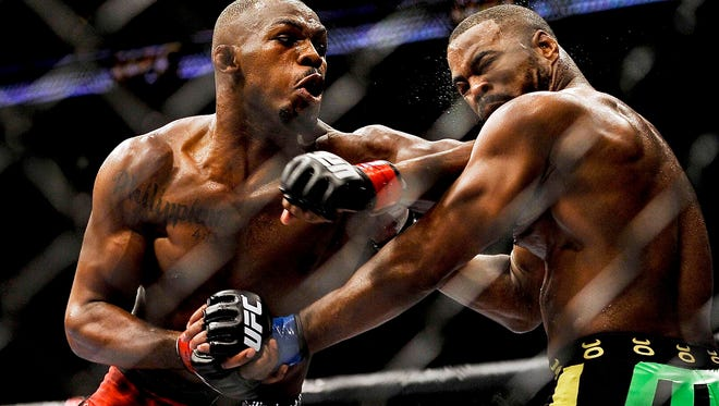 Jon Jones, left, fighting Rashad Evans during UFC 145 in 2012, is from New York, where the sport is banned professionally.