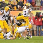 In this Jan. 1 file photo, LSU wide receiver Odell Beckham (3) leaps over his teammate during the first half against the Iowa Hawkeyes during the Outback Bowl at Raymond James Stadium in Tampa, Fla. Beckham is one of several wide receivers Kansas City is considering for the NFL Draft.