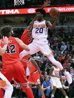 Phoenix Suns forward Josh Jackson (20) attempts to shoot the ball against Chicago Bulls center Robin Lopez (42) during the first half at the United Center.