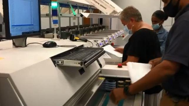 Mail ballots being processed at the Rhode Island Board of Elections Tuesday night.