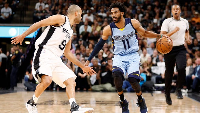 Memphis Grizzlies point guard Mike Conley (11) dribbles the ball as San Antonio Spurs point guard Tony Parker (9) defends during Game 2 of the first-round series on April 17, 2017.