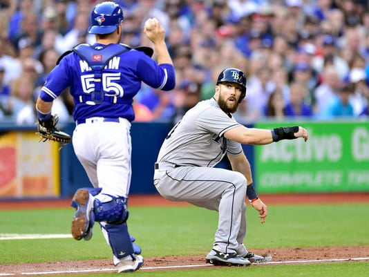Toronto Blue Jays catcher Russell Martin (55) approaches Tampa Bay Rays' Steven Souza Jr. in a rundown during the third inning of a baseball game Tuesday, June 13, 2017, in Toronto. (Frank Gunn/The Canadian Press via AP)