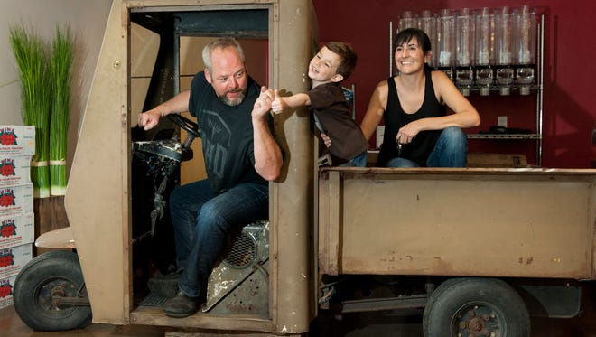 James and Michelle Jessen, and son Levi, 3, of Tazzaria: Fine Foods/Delicatessen are making delicious burgers with 80/20 Wood Fired Burgers on Friday, October 16, 2015.