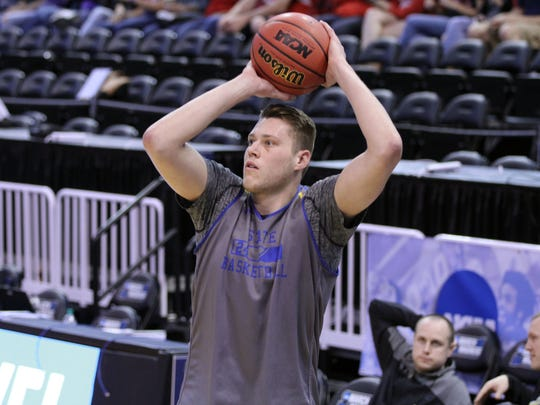 South Dakota State's Mike Daum fires off a 3-point