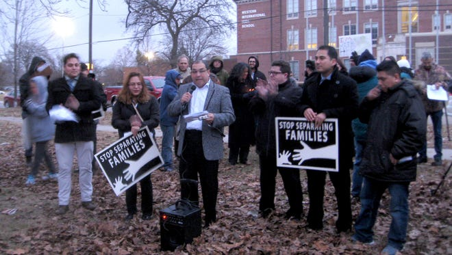 Jaime Diaz-Herrera, center, with a parents group at Western International High School, speaks out on Feb. 15, 2017, in Clark Park in Detroit, next to Western International High School. He is part of the immigrants and advocates  speaking out about federal raids on immigrants.